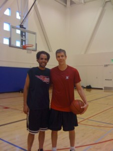 the Secretary of Education, Arne Duncan, and me after a basketball game.
